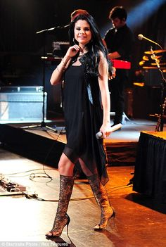 #SelenaGomez #fashion #movies and #music  These boots are made for dancing! Selena Gomez spices her act up with lacy knee-highs as she takes to the stage