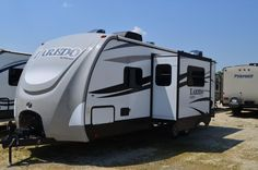 """PRE-OWNED BUNKHOUSE WITH CAMP KITCHEN  2016 Keystone Laredo LHT 25BH This lovely Laredo LHT bunkhouse-style travel trailer is a great pre-owned model at a great price! Measuring 28' 9"""" long and weighing 5560 lbs dry, it offers a lot of living space in a lightweight package. Full kitchen, full bath, big dinette, queen bed, camp kitchen, and more will delight you! Give our Laredo expert Sandi Ballard a call 810-691-8465 for pricing and more information."""