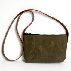 This waxed canvas leather strap field tan colored cross body is quality workmanship + simple design. I wanted to create a cross body that was just the right size for everyday use and to carry your daily essentials. It is durable and water resistant. The handles are reinforced with rivets and by a...