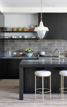 dark wood + shelving + tile backsplash