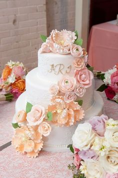 my cake from Sweet Memories, bridesmaids bouquets around it by @embellishedblms , photo by @swankstacy