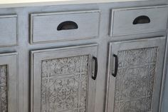 Faux Tin Tile Cabinets  http://www.infarrantlycreative.net/2011/07/faux-tin-tile-cabinets.html