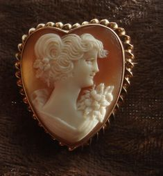 Love that this cameo is heart shaped //Lovely 10K Vintage Hand carved Shell HEART Cameo brooch Pin Pendant