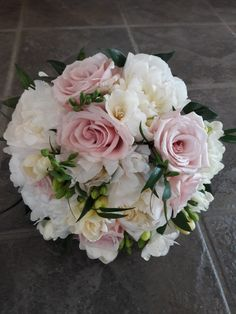 Peonies, roses and freesia bridal bouquet.