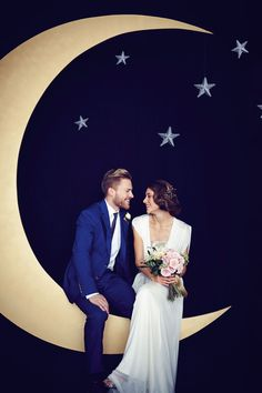 Add real star quality to your photobooth with this breathtaking moon backdrop, as seen on BridesMagazine.co.uk (BridesMagazine.co.uk)