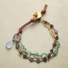 "CONCORDIA BRACELET - Apatites, garnets and 22kt gold plate collaborate in a three-strand alliance. Exclusive with leather cord, sterling silver and a chalcedony bauble. Hook clasp. Handmade in USA. 7"" or 8""L."