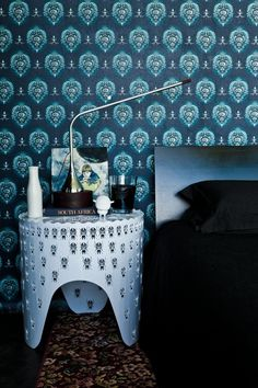 Egg Designs Fleur d' Lys wallpaper, mortar & pestle lamp & bug side table.