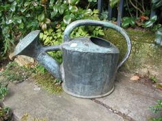 I love old watering cans