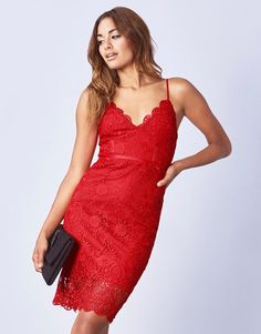 Step out in style in this stunning red cami dress by Lipsy. With all over lace, corset silhouette and plunge neckline, this dress is sure to make an impact. Wear yours with sky-high heels to the party.