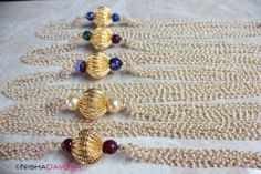 £24 A multi layered mala necklace with tiny pearl seed beads and a feature gold bead as the focal point.  Stunning and lush looking.  Length 34cms  Shop Online Worldwide Delivery #indianjewelry #mala #longnecklace #pearlnecklace #