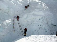 The Ladder of Death on the North Col  The crevasse they are crossing is thousands of feet deep....