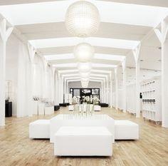Corporate offices in Copenhagen. All white, capiz round chandeliers, wood floors.