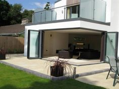White wood windows, Bifold doors Orangeries and Conservatories - Poole, Southampton, Bournemouth Dorset Cantilever Architecture, Futuristic Architecture, Aluminium Windows And Doors, Wood Windows, Upvc Windows, Bay Windows, Glass Extension, Extension Ideas, House Extensions