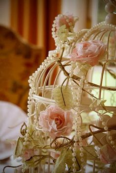 Beautiful birdcage decorated with pearls and roses
