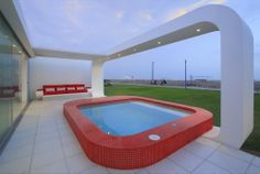 Jazzy Beach House in Breezy Look: Stylish Red Outdoor Swimming Pool Of Contemporary House In Palabritas Beach Combined With Built In Sofa Wi. Outdoor Swimming Pool, Swimming Pools, Residential Architecture, Modern Architecture, Pictures Of Porches, Built In Sofa, Beach Properties, Outdoor Living Areas, Living Spaces