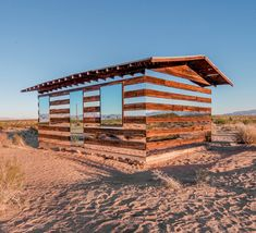 Half Invisible: Deserted Desert Cabin Remixed with Mirrors