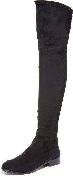 Over-the-knee Dolce Vita boots made from comfortable stretch suede. Cords cinch the top, and a zip closes the side. Low, stacked heel. Synthetic sole with rubber patches. <ul> <li>Fabric: Faux leather.</li> <li>Imported, China.</li> <li>Measurements</li> <li>Heel: 1.25in / 30mm</li> <li>Shaft: 22.75in / 57.5cm</li> <li>Circumference: 15in / 38cm</li> </ul>