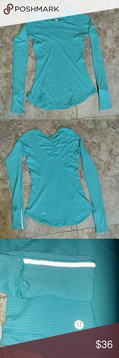 Lululemon Long Sleeve Running Shirt 6 Excellent condition! Silver scent to keep stink at Bay. Thumb holes and cuffs that will fold over to keep hands warm. Light weight and super flattering cut! Great for workouts or just casual wear! Size 6. Thanks for looking :) lululemon athletica Tops