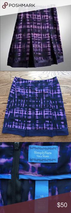 Adorable navy and purple print skirt. Adorable navy and purple print skirt.  NWOT.      21 inches long. It has 2 pleats on the front and is 100% polyester. It is unlined, but you cannot see through it. There is a back zipper with a hook and eye. Simply Vera Vera Wang Skirts