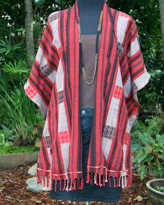 One of a kind women's tribal kimono jacket in ethnic Naga woven cotton. Ethnic Naga woven cotton in red, brown, tan and black, bits of fringe complete this truly tribal piece.Free style fits most from small to xlEthnic Naga woven cottonButterfly s...