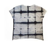 """<p>When you hear """"hand-dyed, eco-friendly T-shirt,"""" you probably don't picture this hyper-sophisticated top that Tara St James of Study made for us. She's given the basic gray tee you wear, oh, at least twice a week a major upgrade by starting with heathered organic cotton and shibori-dyeing it with a black grid pattern. It pops with silk shorts, washed-out jeans, and even tuxedo pants (genius, right?).</p>"""