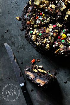 Fatty Bars ~ A sweet and salty brownie stuffed with Reese's Peanut Butter Cups and finished with crushed Pretzel M&Ms and Fritos