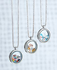 Floating Charm Locket Necklace is a fun piece to add to your jewelry collection. Its pendant is a unique twist on the traditional locket, featuring a see-through circle filled with coordinating charms. Has a magnetic closure. Open it up to remove charms