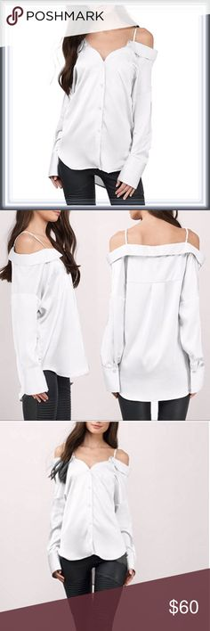 a2d09f91ca3a Button Down Cold Shoulder Top ➖SIZE: Small, Medium, Large ➖STYLE: A white  button down with a cold Shoulder design and a Ruffle folded down collar.