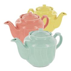 Pastel teapots in yellow, pink, and blue.