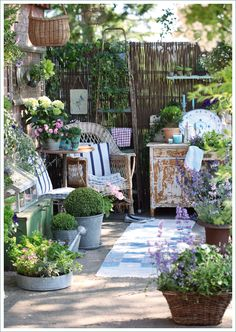 Vintage furniture, hand-me-down accessories makes this garden space perfect!!