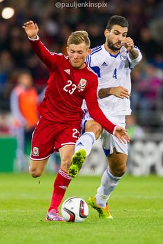 George Williams battles with a Cyprus defender.