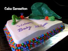The Very Hungry Caterpillar Baby Shower Cake... by Cake Sensations in Bath, Maine