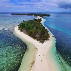 Dodola Island, Morotai, North Maluku, Indonesia. Dodola Island is a real paradise. The beauty of the beach is very tempting. It is not surprise because the island becomes an icon of Morotai which is surrounded by huge white sand to connect Big Dodola Island and Small Dodola Island.