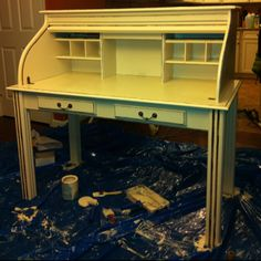 Roll top desk that I picked up for free & then sanded & painted to match my cabinets. :)