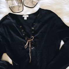 Bebe Lace-Up Top Some fraying on the bottom, shown above. Other than that, no flaws.  Pet friendly home Feel free to ask any questions! Bundle 2+ items for additional 10% off bebe Tops Tees - Long Sleeve
