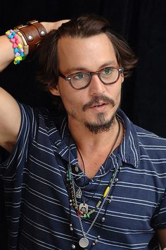 I've noticed that Johnny wears this brown leather band, or watch around his arm, almost all the time. I've realized the significance of the beaded, colorful bracelet, he wears that for his daughter. Haven't figured out the significance of the brown leather arm band yet.