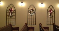 Church Christmas decor, our sanctuary doesn't have windows so I used gothic garden trellises from lowes to mimic windows