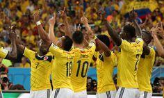 Jogadores colombianos comemoram a classificação inédita