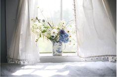 pom pom curtains via Amy Merrick Brooklyn florist