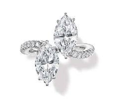 Harry Winston ring set with two marquise-cut diamonds, with an undulating band set with round brilliant diamonds.