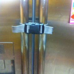 Home-made child-proof lock for side by side fridge.  Parachute buckle $1.97 @ walmart and roll of webbing $1.47 (both found in the craft/sewing section).