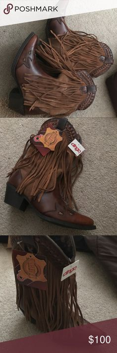 Never worn dingo fringe boots Never worn. Fringe authentic dingo boots. Tags still on them. Size seven. Leather and suede. dingo Shoes Heeled Boots