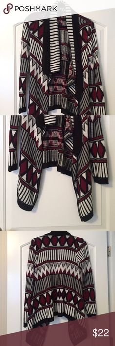 Full Tilt Geometric Print Flyaway Sweater Size XS This is a Full Tilt brand Flyaway Sweater in a black/red/gray/white geometric tribal style print. It is an XS, but runs large. Excellent condition. Smoke free home. Full Tilt Sweaters Cardigans