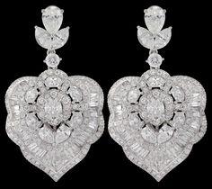 http://www.NiravModi.com/ Bodhi #Earrings w/ leaves of oval, pear, marquise, calibré-cut baguettes and patented Mughal-cut diamonds.