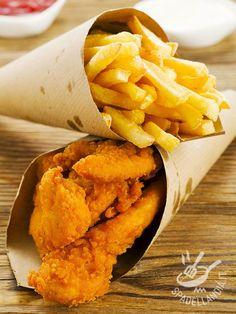 Gustate i vostri Nuggets di pollo davanti alla tv con una buona birra ghiacciata servendoli caldi caldi. E fateli assaggiare ai bambini: ne andranno matti! #nuggetsdipollo