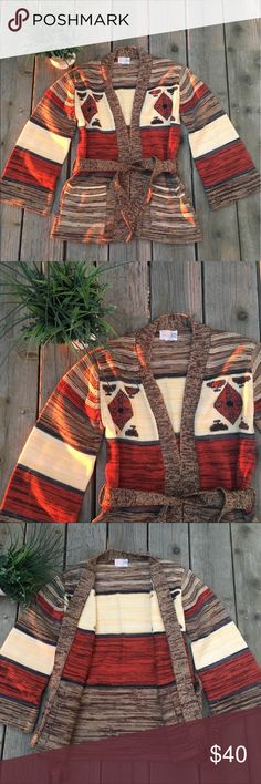 🍃🌹🦋Vintage Aztec Cardigan🦋🌹🍃 🍃🌹Stunning Vintage Aztec Cardigan🦋🌹🍃 Founf this Beauty at a Local Boutique. Love it, but it's a tad too big for me. I was hoping to wear it this Season but decided to part with it. It has a Gorgeous color combination of Browns, Oranges and Creams with a hint of Blue. It has pockets and a tie for closure. It has an amazing print that's fun and unique! You won't find this ANYWHERE! Great condition! Comes from a smoke-free, pet-free home:)♥️ Fine Quality…