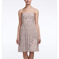 Short Allover Print Crinkle Chiffon Dress Style: F115667  A fun and ultra-feminine print will give your bridal party a unique flair!  Strapless allover print bodice with sweetheart neckline features ruched bust that creates texture.This short crinkle chiffon dress hits right above the knee.Fully lined. Back zip. Imported polyester. Dry Clean. David's Bridal Dresses Midi