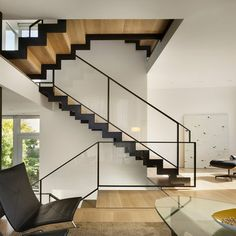 wood under the stairs is a neat architectural design element