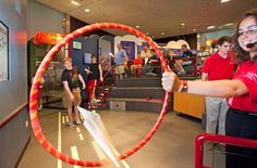 Target practice for paper airplane contest (hang hula hoops from ceiling)