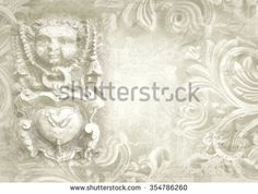 Architectural details. Antique wall in grunge style with meander, capitals, friezes. Art deco figures carved on stone as decoration on a facade building. Fragment of ornate relief.